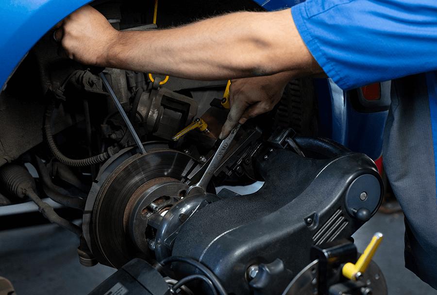 Autosmith technician servicing brakes