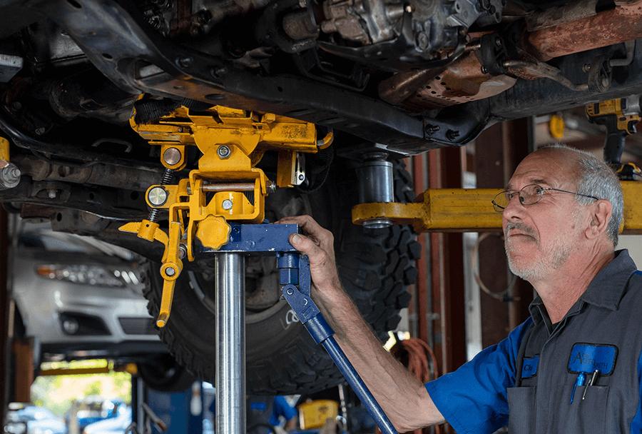 Autosmith technician servicing transmission
