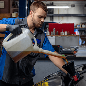 Autosmith technician filling oil