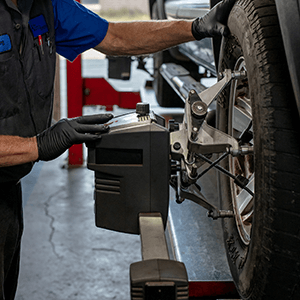Autosmith technician servicing tires